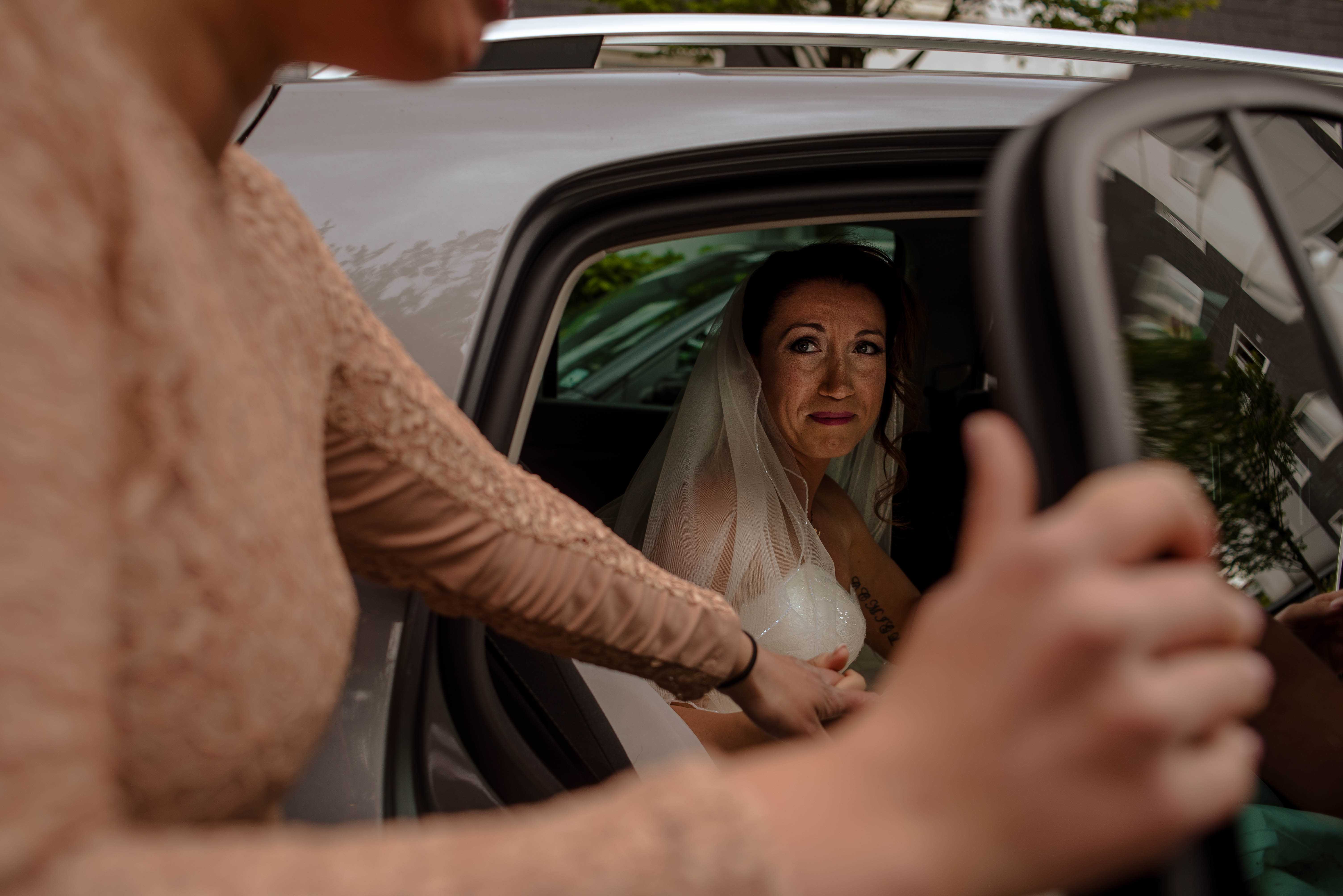 bride getting into cab