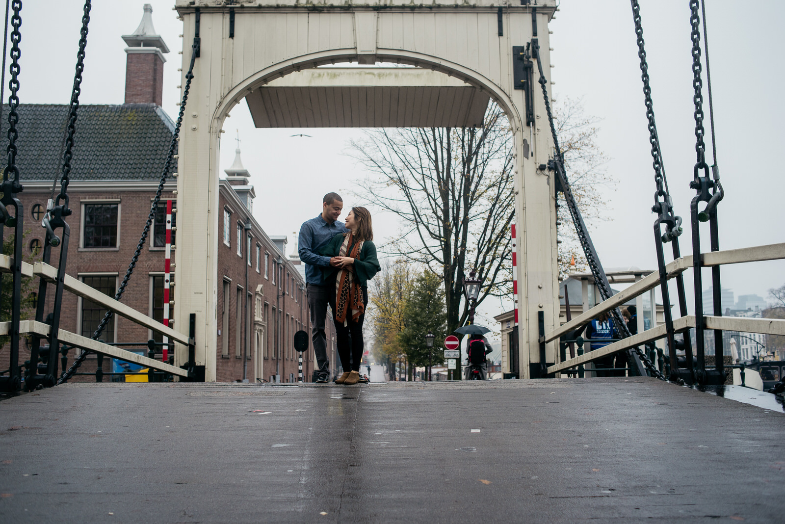 Couple on a bridge at Waterlooplein during a family shoot in Amsterdam